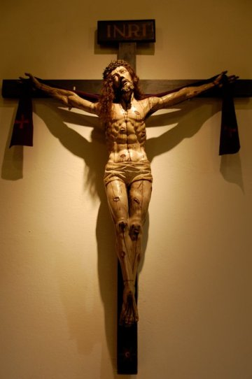 The Christinane symbol of the crucifixion is mundane death.